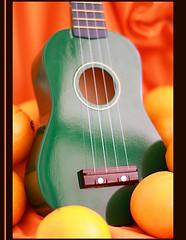 Orange Ukulele (Charlie Cruise) Tags: green fruit canon 50mm ukulele oranges stings intrument