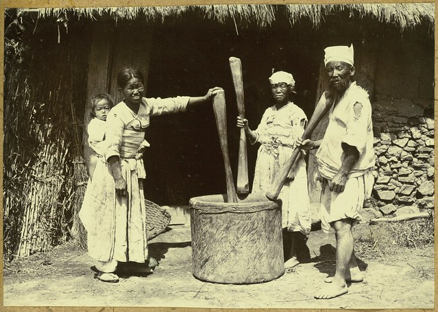 [Peasant pounding rice]