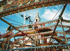 (lily austin) Tags: uk blue england sky cold colour film lights markets german merrygoround disposable