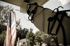 Jury rigged Patriotism (rakeif) Tags: film analog america flag americanflag american 35mmfilm m42 fujifilm patriotism vivitar starsandstripes macgyver juryrig juryrigged flagholder m42lens filmslr 35mmslr macgyvered bungiecord searstls ricohtls m42camera