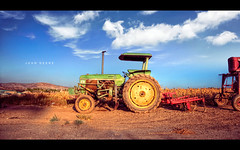 Tractor in Suburbia (isayx3) Tags: blue sky tractor color field clouds corn nikon skies farm vibrant explore handheld 365 24mm nikkor frontpage f28 hdr d3 johndeere plainjoe isayx3