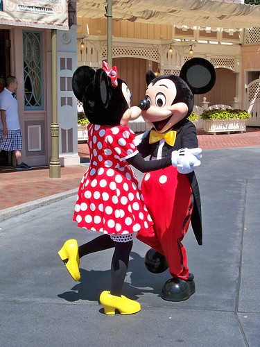Minnie and Mickey dance to the Celebration Band