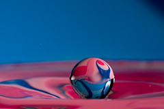 Floating Marble (spettacolopuro) Tags: pink blue wild color macro reflection art texture nature water glass colors closeup canon reflections lens fun drops amazing cool interesting fantastic waves close magic flash cyan wave natura mini drop best fantasy tiny impact transparency refraction imagination suspended marble splash acqua magical riflessi bounce multicolor onde onda riflesso goccia gocce waterreflections timing secretworld macrofotografia davidcopperfield trasparenza glasssphere magicsphere andrearossi rimbalzo flickrsbest naturallens bounces 40d abigfave sospesa waterlens ef180mm colorphotoaward embeddedworld canonspeedlite580exii pinklogo spettacolopuro masteroftexture