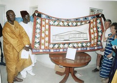 The Minister holds the Wall Hanging