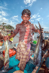 A fisherman with his catch
