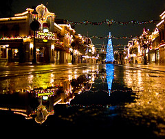 main street, u.s.a. (deb1edeb) Tags: california holiday reflection rain night canon unitedstates disneyland orangecounty anaheim 2009 themepark mainstreetusa disneylandresort powershots90