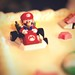 Mario on the birthday cake, with Princess Peach in hot pursuit