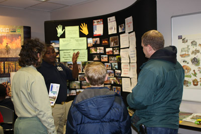 Blackwell student Mario Davis from Inkster, MI, describes his part in the restoration work to Open House visitors.