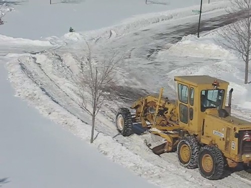 Road Grader Clearing the Streets of Snow