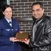 Ahsan Qureshi presnting Saclg honour shield to Nicole Warner of Victoria Police