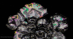 A crazy birefringent flake (Detached Retina) Tags: snowflake winter white up de crystals chaos close neige icy macros snowfall wintery flocon schneeflocke    lumehelves