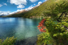 Circumnavigating the Lake (Stuck in Customs) Tags: world chile travel autumn trees red sky patagonia foothills mountain lake mountains cold color reflection southamerica nature water argentina argentine colors leaves clouds america landscape lago photography high nikon scenery day republic dynamic stuck outdoor hiking district south scenic hike glacier foliage growth highland photograph andes april resolution wilderness top100 portfolio lush range 2009 hdr slope trey rugged customs density elchalten circumnavigating ratcliff stuckincustoms d3x