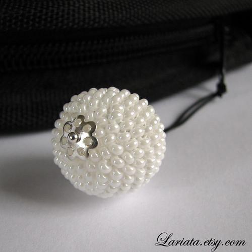 white beaded bead