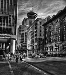 Downtown Vancouver, British Columbia (HDR) (Brandon Godfrey) Tags: vancouver britishcolumbia bc downtown buildings monochrome blackandwhite crosswalk pedestrians traffic cars metro metrovancouver city urban hdr highdynamicrange tonemapped tonemapping photomatix 2010olympics 2010 canada canadian olympics cityscape old heritage harbourcentre howest waterfront lowermainland streets glass reflection reflections western top