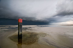 Nowhere to go.. (Danil) Tags: red seascape storm holland beach netherlands dutch strand landscape island wadden daniel tide dune wide nederland noordzee pole northsea simplicity thunderstorm lonely groningen friesland schiermonnikoog landschap duin onweer d300 getijde alleenophetstrand