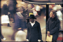 Chaos of Oxford street (Che-burashka) Tags: street people urban motion blur london hat shopping 50mm mess chaos busstop busy motionblur oxfordstreet crowds blurredpeople fromthebus londonist 400d urbanlyric handheldfromthebus kisseshappynewweek