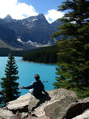 Moraine Lake (Jessica Matteazzi) Tags: travel blue trees boy shadow vacation sky lake holiday snow canada man mountains green nature water clouds forest landscape outdoors person boat scenery rocks arm stones tourist canoe alberta environment breeze touristattraction morainelake therockymountains coniferoustrees