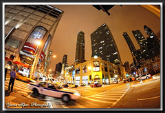 Loop (Yavuz Alper) Tags: november usa chicago cold building fall night corner nikon midwest downtown traffic loop chitown fisheye michiganavenue hancock 2009 skycrapers yavuz alper yalper gencaliolu wetertower