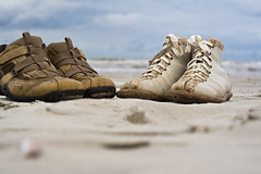 Old shoes on the beach