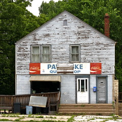 FSA style - flat as a pancake (Pawloske's Quick Shop) (kevin dooley) Tags: road old house building history car sign shop architecture rural america canon 50mm drive us photo highway mainstreet midwest closed paint photographer flat michigan farm 14 poor bad documentary indiana coke lakemichigan business route american beat lakeshore service cocacola pancake 12 roadside straight decrepit 2d quick beaten chipped economy johnnys peeled rundown fsa jobless michigancity bankrupt michiana f35 recession smallbusiness 40d economiesofscale historicaldefeated pawloske pawloskes