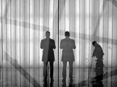 Double Self-Portrait With Old Man (an untrained eye) Tags: selfportrait newyork reflection topf25 silhouette topv111 topf50 topv555 topv333 unitedstates manhattan topv222 wtc bandw groundzero littleoldman anuntrainedeye viewingcenter doubleactually whichslightlyfreakedmeoutifimhonest itwaspartofanexhibitionongermanythoughimdarnedifiunderstandthesupposedsignificance itgivesthepictureaslightlyexpressionistnoirishfeelthoughsoimnotcomplaining ifeltabitlikeiwasgilbertgeorgebothatthesametimeasitookit ofcoursehemakesit hecametaptaptappingbyjustattherightmoment notsureaboutthewholespiderswebthingthatsgoingonthere