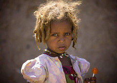Afar girl with lollipop in Asaita, Danakil, Ethiopia (Eric Lafforgue) Tags: africa portrait people face horizontal photography day child serious african culture tribal innocence females tradition ethiopia tribe ethnic oneperson tribo frontview traditionalculture hornofafrica individuality ethnology headandshoulders ethiopian afar eastafrica thiopien etiopia ethiopie traditionalclothing realpeople etiopa colorimage lookingatcamera 45years  traveldestination danakil etiopija 1people pastoralist ethiopi  africanculture onegirlonly etiopien etipia  etiyopya  mg0957   asaita  assayta