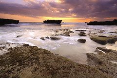 Siren's Song (tropicaLiving - Jessy Eykendorp) Tags: longexposure light sunset sea sky bali seascape beach nature water silhouette clouds canon indonesia landscape eos coast rocks shoreline efs 1022mm echobeach canggu 50d outdoorphotography canoneos50d sirenssong bwcpl tropicaliving hitechfilters vosplusbellesphotos rawproccessedwithdigitalphotopro tiffproccessedwithadobephotoshopcs3 hitechfilterndgrad
