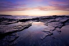 Normal Service Will Resume Shortly (jasontheaker) Tags: sunset sea holiday sand rocks cornwall atlantic slate 2009 padstow trevone jasontheaker trevosehead