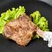 ribeye steak on black plate or pan