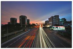 Dusk in Kota Kinabalu (Nora Carol) Tags: dusk kotakinabalu lighttrails sabah slowshutterspeed malaysianphotographer urbansunset noracarol kotakinabalusunset sabahanphotographer wismatunfuad karamunsingnikond90 landscapephotographerfromsabah womanlandscapephotographer womaninphotography
