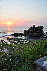 Tinah Lot (rosswebsdale) Tags: sunset sea bali cloud sun rock indonesia temple coast arch indo 2009 bintang tanahlot seminyak