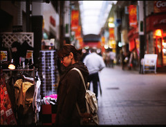 (yugoroyd) Tags: portrait people film girl japan 35mm canon dof kodak bokeh 55mm zuiko eos3 f12 100vs