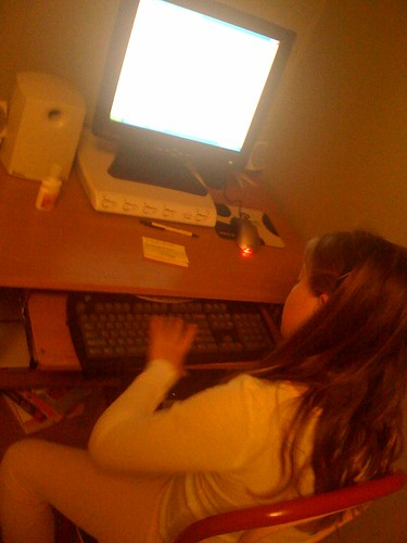 Taylor typing up her blog