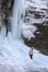 Is it safe? (gwhiteway) Tags: icicles overhang cliffs nature newfoundland waterfall frozen stalactites stone rocks winter icy snow outdoors falling danger risk beach newfoundlandandlabrador canada water middlecove tourism