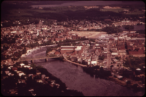 The Androscoggin River Flows between Lewiston (Eastern Shore) and Auburn (Western Shore) ... 06/1973