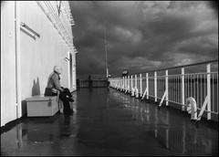 Looking outside the boat 3/3. (flevia) Tags: bw ferry analog blackwhite balticsea baltic bn nophotoshop biancoenero nikonfa foma analogico fomapan nikkor35mmf2 trombonave scannednegatives fomapan400 epsonv700 marbaltico thebaltics autaut epsonperfectionv700photo flevia inmezzoalmare imanalog lookingoutsidetheboat