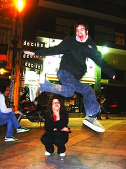 Vasilis jumping over Georgia at Navarinou square, Thessaloniki, Greece (onesecbeforethedub) Tags: pictures life blue girls boy people woman man men art boys girl smile face living fly flying photo jump jumping nikon women funny faces jean image skin action pics head touch picture pic images jeans jacket photographs photograph technical thessaloniki concept bluejeans conceptual 2009 touching situationism situ d60 bluejean flusser vilem nauarinou situationisme