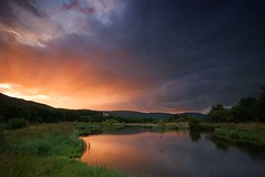 Sunset at Rothiemurchus (Semi-detached) Tags: park sunset lake fish clouds evening scotland fishing united dramatic scottish kingdom sunny august hills national loch trout leap 2009 aviemore leaping cairngorm cairngorms rothiemurchus fishery pityoulish