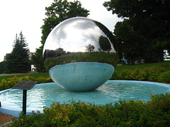 The Invisible Photographer (zJMac) Tags: world park blue trees light shadow summer sky sculpture white ontario canada cold reflection green water pool metal stone clouds standing canon silver ball dark grey reflecting daylight shiny day waves sitting shadows view ottawa watching gray floating wave sphere reflective lonely ripples placement gazing nrc zjmac mtrtrophyshot