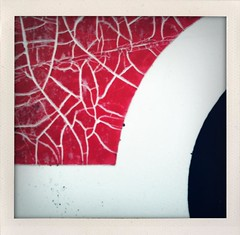 Do you hear the crackling (ale2000) Tags: red white abstract black macro geometric sign square fake cracks astratto rosso bianco nero forme 3gs iphone geometria iphone365 ipolaroid shakeitphoto