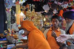 Girl Checking stuff out (kumarh2o) Tags: food india lake cold cooking water temple gold golden big bath worship prayer guard ripleys parade fields carps carp sikh bathing sahib punjab amritsar gurudwara soni sikhism punjabi spear