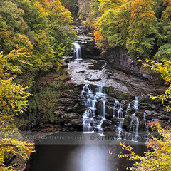 Corra Linn (Falls of Clyde) (Stuart Stevenson) Tags: autumn trees red cliff colour green fall leaves yellow canon woodland gold scotland riverclyde waterfall rocks canon300d stuart stevenson gorge ochre turner newlanark clydevalley fallsofclyde corralinn jmwturner hydroelectricpowerstation fallsofclydereserve stuartstevenson notinspate
