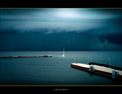 HOME BEFORE THE RAIN STORM.. (bert.raaphorst) Tags: storm rain sailboat denmark harbour safe langeland coth objectiveart bagenkop safeharbour elmarit24mm visiongroup somethingblueinmylife homebeforedark artofimages worldsartgallery