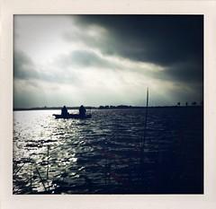 Emmen (YYNTL) Tags: lake holland apple water netherlands boot boat meer fishermen nederland wolken zon bootje riet bewolkt drenthe emmen wandeling iphone vissers zondagochtend zondagmorgen wintertijd rietplas drenthedoetwatmetje