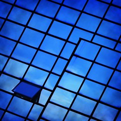 . : 327/365 (helen sotiriadis) Tags: blue sky abstract black reflection building window glass architecture clouds facade canon steel athens 365 tilt curtainwall canon70200f28lisusm canoneos40d toomanytribbles updatecollection