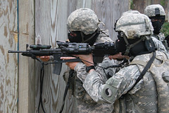 Soldiers conduct close quarters marksmanship training in preparation for duty in Iraq