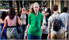 unrestrained thinking (TheeErin) Tags: street people woman inspiration chicago green cane shirt lady bag walking glasses photo walk il purse backpack specs streetphoto michiganavenue rearview poloshirt polo magnificent catwalk mile lostinthought shoppers streetshot magnificentmile magmile chicagoist ambulate