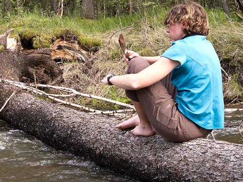 Emma fishing in stream