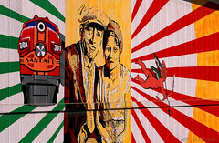 Warbonnet Mural In Topeka (Jeff Carlson_82) Tags: atsf santafe warbonnet oakland neighborhood topeka ks kansas shops emd f7 coveredwagon mural painting jaime colon bnsf