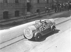 "A sales promotion car done up as a packet of peppermint ""Lifesavers"", Sydney, 27 October 1934 / Sam Hood (State Library of New South Wales collection) Tags: car design roadworks ad convertible advertisement carro artdeco lollies peppermint lifesavers commercialart runningboard tramways roadworkers"